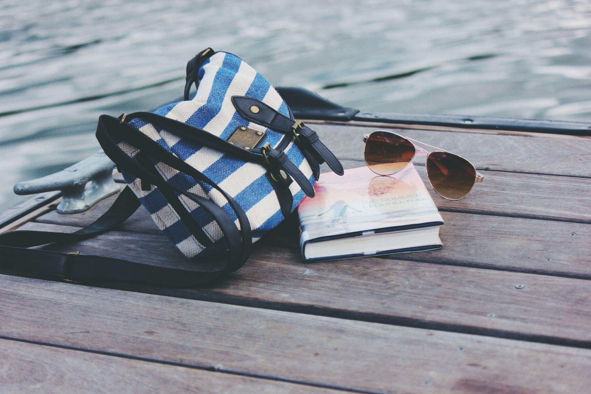 purse and book by the water